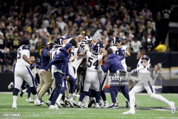 Johnny Hekker and Greg Zuerlein of the Los Angeles Rams celebrate after kicking the game winning field goal in overtime against the New Orleans...
