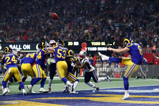 Johnny Hekker of the Los Angeles Rams punts the ball in the third quarter against the New England Patriots during Super Bowl LIII at MercedesBenz...