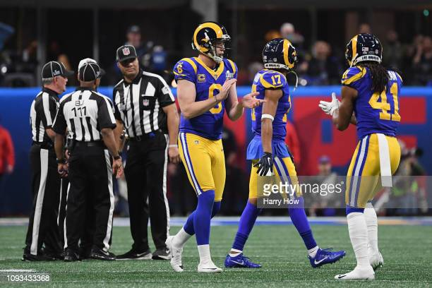 Johnny Hekker, Robert Woods, and Marqui Christian of the Los Angeles Rams react after a call in the first half during Super Bowl LIII against the New...