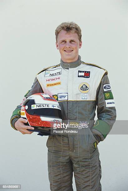 Johnny Herbert of Great Britain driver of the Team Lotus Lotus 107 Ford V8 poses for a portrait during practice for the Yellow Pages South African...