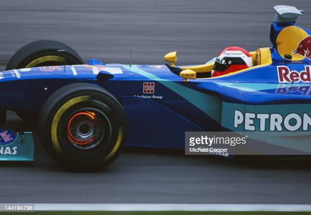 Johnny Herbert of Great Britain lights up the glowing brake discs as he drives the Red Bull Sauber Petronas Sauber C17 Petronas V10 during the...