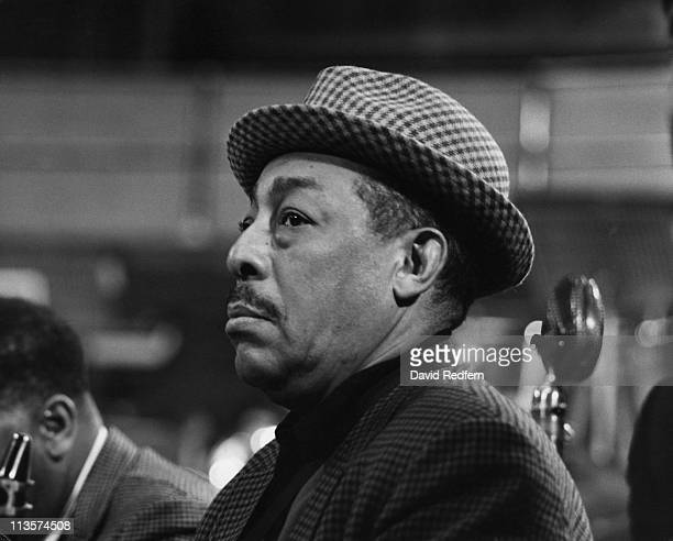 Johnny Hodges US jazz saxophonist wearing a houndstooth check hat during a live concert performance circa 1965