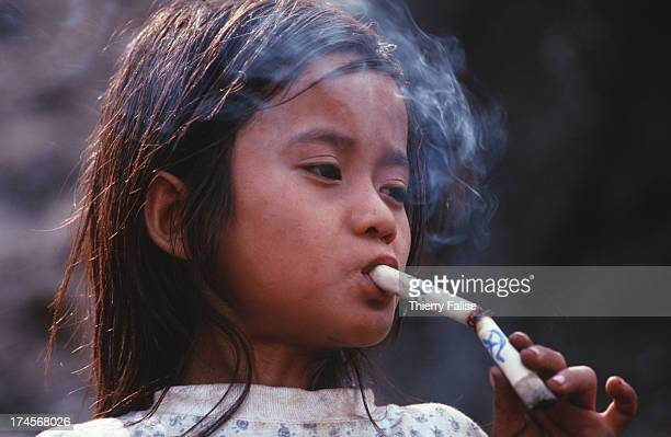 Johnny Htoo chainsmoking in Kamerplaw southern Burma headquarters of God's Army Johnny and his twin brother were the messianic figureheads and...