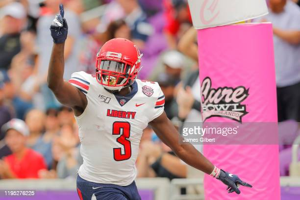 Johnny Huntley of the Liberty Flames celebrates after scoring a touchdown during the first quarter of the 2019 Cure Bowl against the Georgia Southern...