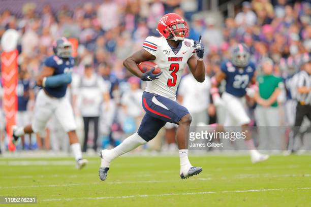 Johnny Huntley of the Liberty Flames scores a touchdown during the first quarter of the 2019 Cure Bowl against the Georgia Southern Eagles at...