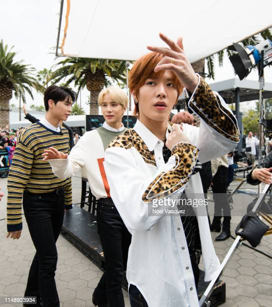 Johnny Jungwoo and Yuta of NCT 127 visit Extraat Universal Studios Hollywood on May 13 2019 in Universal City California