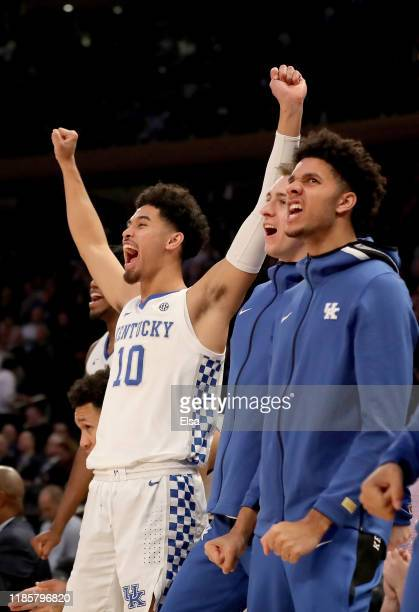 Johnny Juzang of the Kentucky Wildcats celebrates in the final minutes of the game against the Michigan State Spartans during the State Farm...