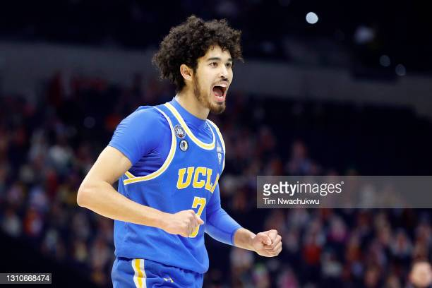 Johnny Juzang of the UCLA Bruins reacts in the first half against the Gonzaga Bulldogs during the 2021 NCAA Final Four semifinal at Lucas Oil Stadium...