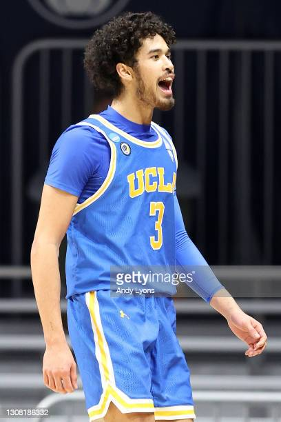 Johnny Juzang of the UCLA Bruins reacts in the first round game against the Brigham Young Cougars in the 2021 NCAA Men's Basketball Tournament at...