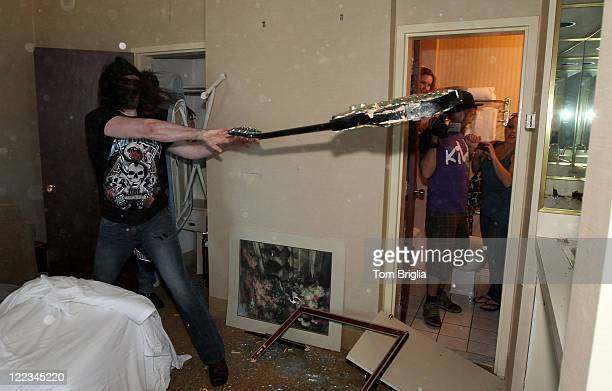 Johnny Klizz of Sinners throws a guitar at a mirror during the Battle of the Room Trashing Bands at Bally's Atlantic City on Friday June 25 2010 in...