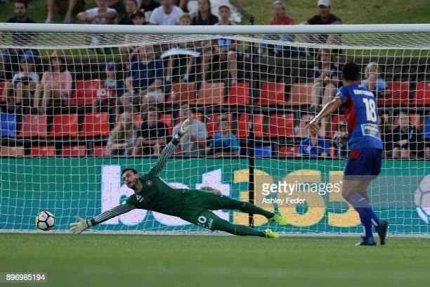 Johnny Koutroumbis of the Jets scores a goal with Vedran Janjetovic of the Wanderers in goal during the round 12 ALeague match between the Newcastle...