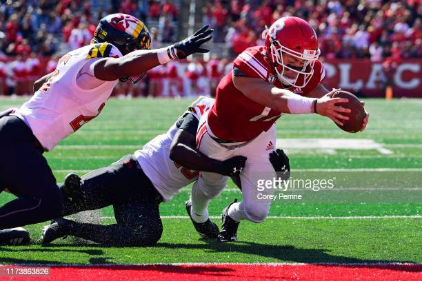 Johnny Langan of the Rutgers Scarlet Knights scores a rushing touchdown against Jordan Mosley of the Maryland Terrapins Antoine Brooks Jr. #25 during...