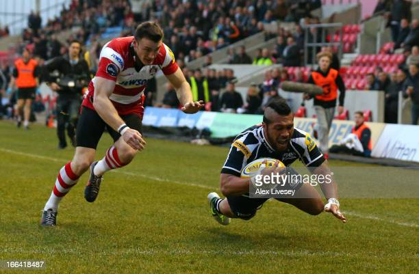 Johnny Leota of Sale Sharks dives over the line to score the opening try during the Aviva Premiership match between Sale Sharks and Gloucester at the...
