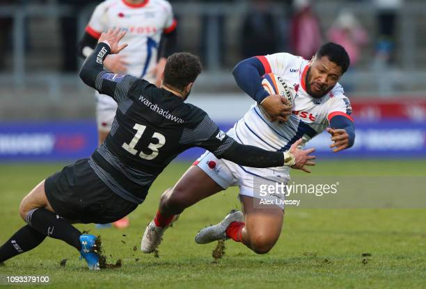 Johnny Leota of Sale Sharks side steps Alex Dunbar of Newcastle Falcons during the Premiership Rugby Cup match between Sale Sharks and Newcastle...