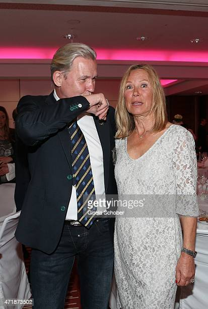 Johnny Logan and his 'kiss on a hand' for Sybille Beckenbauer during the Franz Roth Golf Cup gala evening in favour of Michael Roll Stiftung...