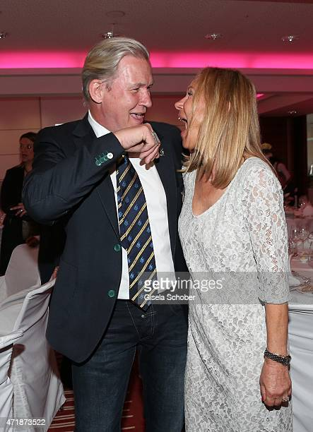 Johnny Logan and Sybille Beckenbauer laugh after his 'kiss on a hand' during the Franz Roth Golf Cup gala evening in favour of Michael Roll Stiftung...