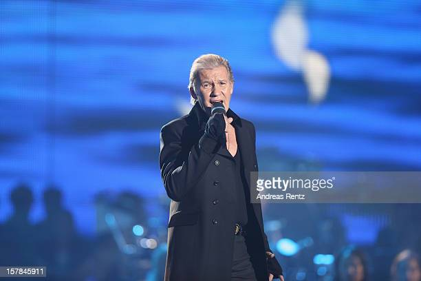 Johnny Logan performs on stage during the Andrea Berg 'Die 20 Jahre Show' at Baden Arena on December 6, 2012 in Offenburg, Germany.