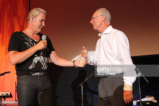 Johnny Logan sings with Franz Beckenbauer at the Kaiser Cup 2014 Gala on July 19, 2014 in Bad Griesbach near Passau, Germany.