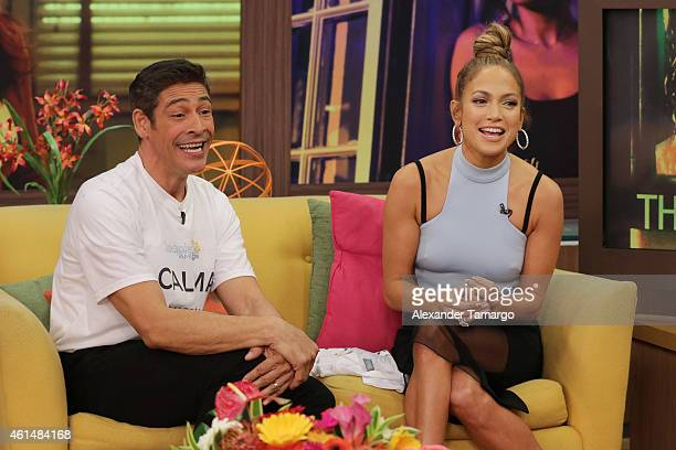 Johnny Lozada and Jennifer Lopez are seen on the set of Despierta America to promote film The Boy Next Doorat Univision Headquarters on January 13...