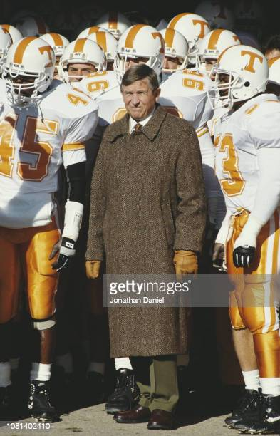 Johnny Majors Head Coach for the University of Tennessee Volunteers stands with his team during the NCAA Southeastern Conference college football...