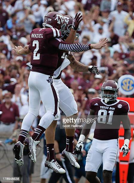 Johnny Manziel and Mike Evans of the Texas AM Aggies celebrates a third quarter touchdown during the game against the Rice Owls at Kyle Field on...