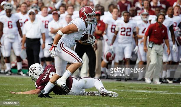 Johnny Manziel of Texas AM Aggies cannot tackle Vinnie Sunseri of the Alabama Crimson Tide as he runs for a 73 yard touchdown after an interception...