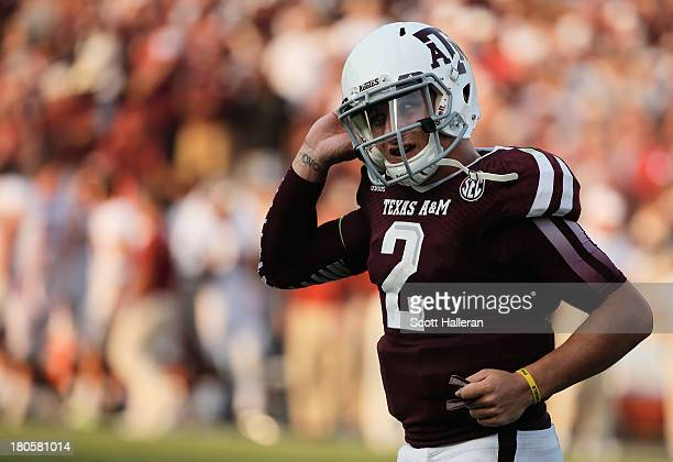 Johnny Manziel of Texas AM Aggies reacts to a play in the fourth quarter during the game against the Alabama Crimson Tide at Kyle Field on September...