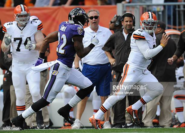 Johnny Manziel of the Cleveland Browns carries the ball in front of Jimmy Smith of the Baltimore Ravens at FirstEnergy Stadium on September 21 2014...