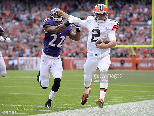 Johnny Manziel of the Cleveland Browns is forced out of bounds by Jimmy Smith of the Baltimore Ravens during the second quarter at FirstEnergy...