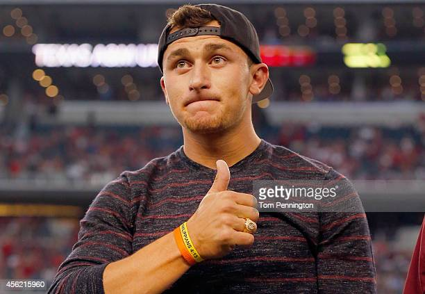 Johnny Manziel of the Cleveland Browns reacts after receiving his Aggie Ring during half time of the Southwest Classic at AT&T Stadium on September...