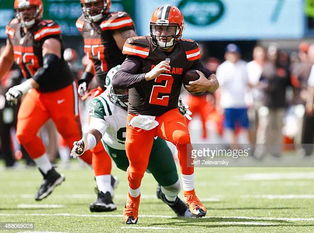 Johnny Manziel of the Cleveland Browns scrambles against the New York Jets during the game at MetLife Stadium on September 13 2015 in East Rutherford...
