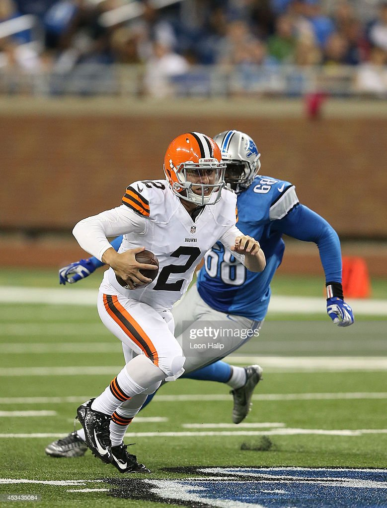 Johnny Manziel #2 of the Cleveland Browns scrambles away from defensive end George Johnson #68 of the Detroit Lions during the third quarter of the preseason game at Ford Field on August 9, 2014 in Detroit, Michigan. The Lions defeated the Browns 13-12 in a preseason game.