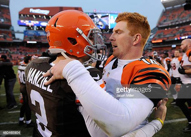 Johnny Manziel of the Cleveland Browns talks with Andy Dalton of the Cincinnati Bengals after Cincinnati's 300 win at FirstEnergy Stadium on December...