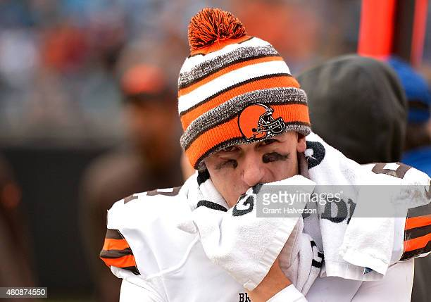 Johnny Manziel of the Cleveland Browns watches from the bench during the second half of a loss to the Carolina Panthers at Bank of America Stadium on...