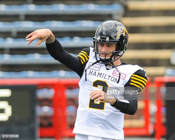 Johnny Manziel of the Hamilton Tiger-Cats during warm-ups prior to a CFL game against the Calgary Stampeders at McMahon Stadium on June 16, 2018 in...