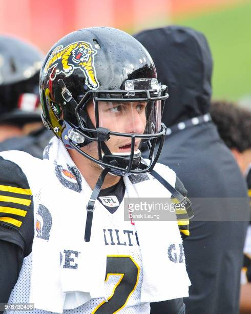 f38c95f84 Johnny Manziel of the Hamilton TigerCats stands on the sidelines during a  CFL game against the