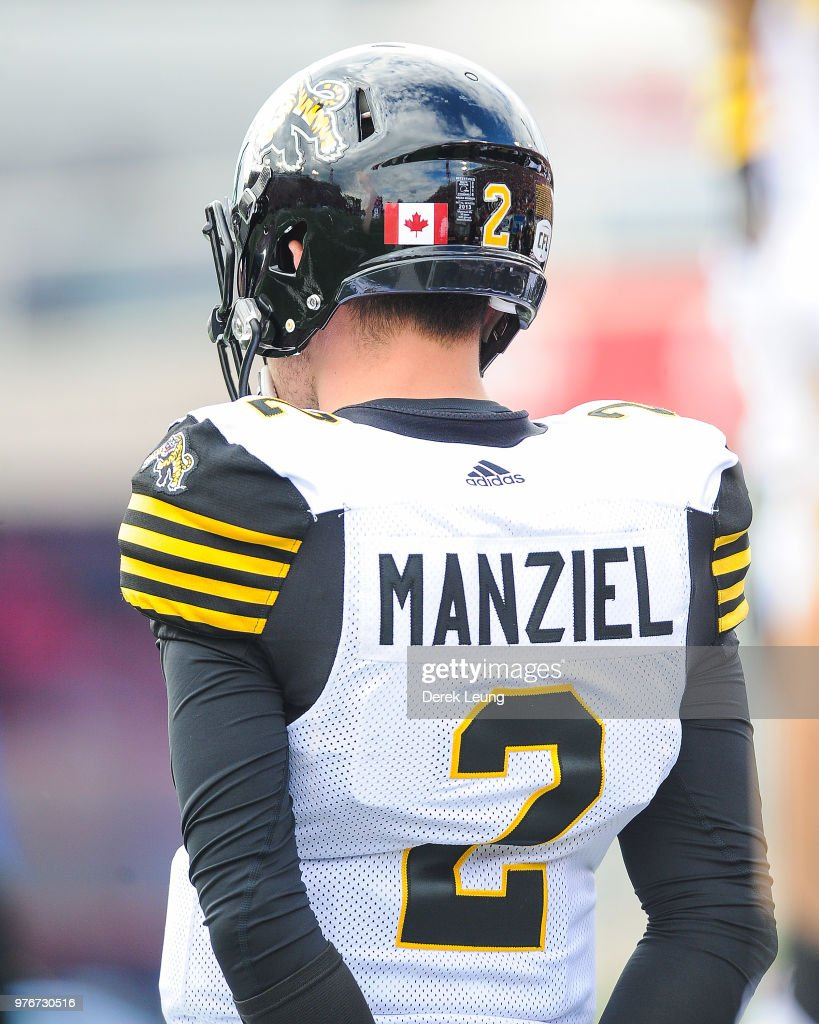 2a4a40732 Johnny Manziel of the Hamilton Tiger-Cats stands on the sidelines ...