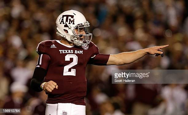 Johnny Manziel of the Texas A&M Aggies celebrates a first quarter touch down during their game against the Missouri Tigers at Kyle Field on November...