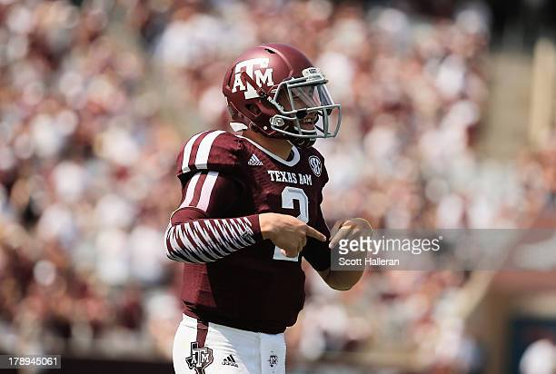Johnny Manziel of the Texas AM Aggies celebrates a fourth quarter touchdown during the game against the Rice Owls at Kyle Field on August 31 2013 in...