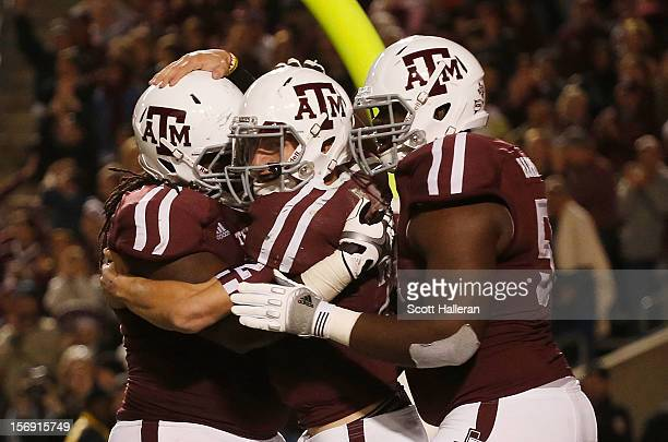 Johnny Manziel of the Texas A&M Aggies celebrates a third quarter touchdown with teammates during their game against the Missouri Tigers at Kyle...