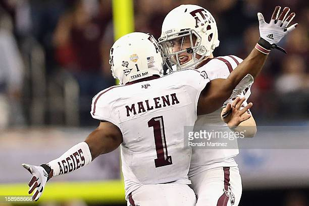 Johnny Manziel of the Texas A&M Aggies celebrates a touchdown with Ben Malena against the Oklahoma Sooners during the Cotton Bowl at Cowboys Stadium...