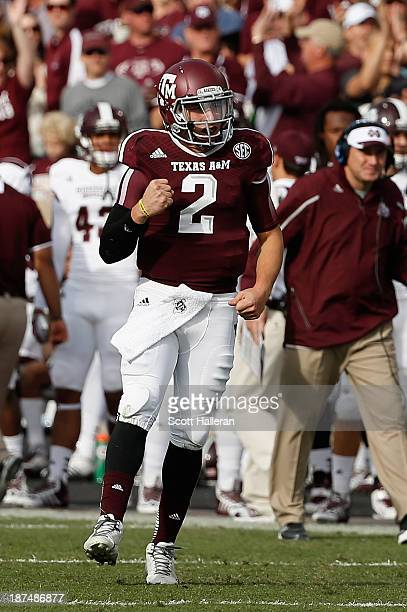 Johnny Manziel of the Texas AM Aggies celebrates after tossing a 12 yard touchdown pass in the first quarter during the game against the Mississippi...