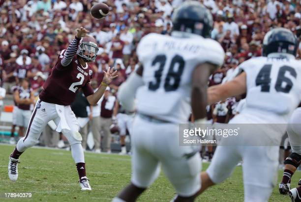 Johnny Manziel of the Texas AM Aggies drops back to pass in the third quarter during the game against the Rice Owls at Kyle Field on August 31 2013...