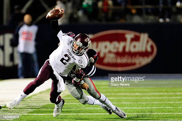 Johnny Manziel of the Texas AM Aggies is tackled by LaKedrick King of the Ole Miss Rebels during a game at VaughtHemingway Stadium on October 6 2012...
