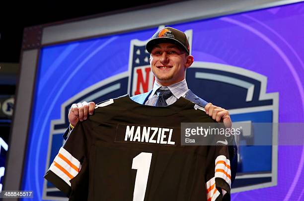 Johnny Manziel of the Texas AM Aggies poses with a jersey after he was picked overall by the Cleveland Browns during the first round of the 2014 NFL...