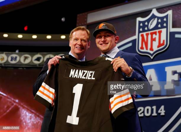Johnny Manziel of the Texas A&M Aggies poses with NFL Commissioner Roger Goodell after he was picked overall by the Cleveland Browns during the first...
