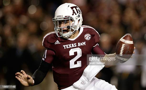 Johnny Manziel of the Texas A&M Aggies runs upfield during their game against the Missouri Tigers at Kyle Field on November 24, 2012 in College...