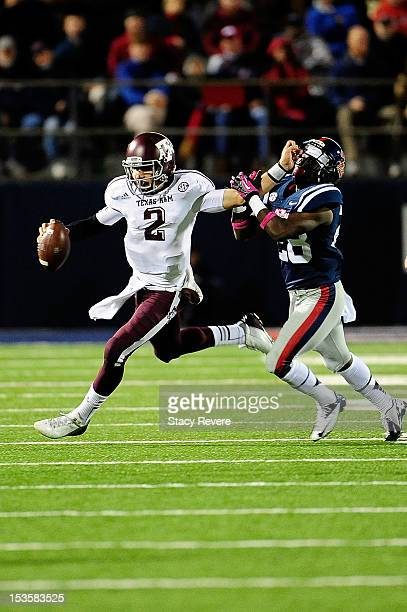Johnny Manziel of the Texas AM Aggies stiff arms LaKedrick King of the Ole Miss Rebels during a game at VaughtHemingway Stadium on October 6 2012 in...
