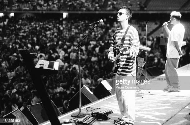 Johnny Marr and Bernard Sumner of British dance music duo Electronic performing on stage at the Dodgers Stadium Los Angeles USA 4th August 1990