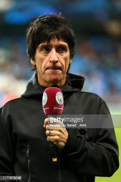Johnny Marr former band member of The Smiths and Manchester City fan looks on prior to the UEFA Champions League group C match between Manchester...
